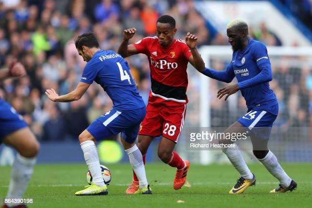 Andre Carrilo of Watford is tackled by Tiemoue Bakayoko of Chelsea and Cesc Fabregas of Chelsea during the Premier League match between Chelsea and...