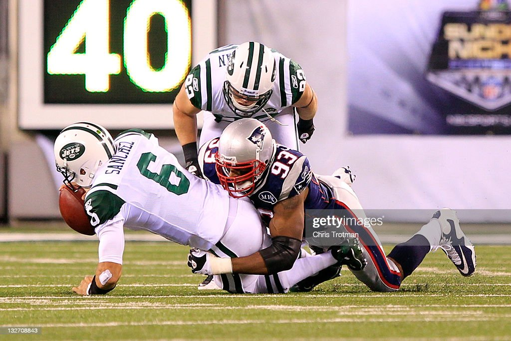 <a gi-track='captionPersonalityLinkClicked' href=/galleries/search?phrase=Andre+Carter&family=editorial&specificpeople=213649 ng-click='$event.stopPropagation()'>Andre Carter</a> #93 of the New England Patriots sacks <a gi-track='captionPersonalityLinkClicked' href=/galleries/search?phrase=Mark+Sanchez&family=editorial&specificpeople=690406 ng-click='$event.stopPropagation()'>Mark Sanchez</a> #6 of the New York Jets at MetLife Stadium on November 13, 2011 in East Rutherford, New Jersey.
