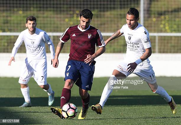 Andre Carvalhas of CD Cova da Piedade with Carlos Eduardo of AC Viseu in action during the Segunda Liga match between CD Cova da Piedade and AC Viseu...