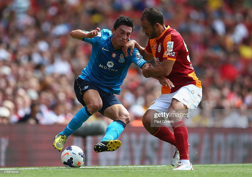 <a gi-track='captionPersonalityLinkClicked' href=/galleries/search?phrase=Andre+Castro&family=editorial&specificpeople=7124527 ng-click='$event.stopPropagation()'>Andre Castro</a> of FC Porto battles for the ball with Nordin Amarabat of Galatasaray during the match between Galatasaray and FC Porto at Emirates Stadium on August 3, 2013 in London, England.