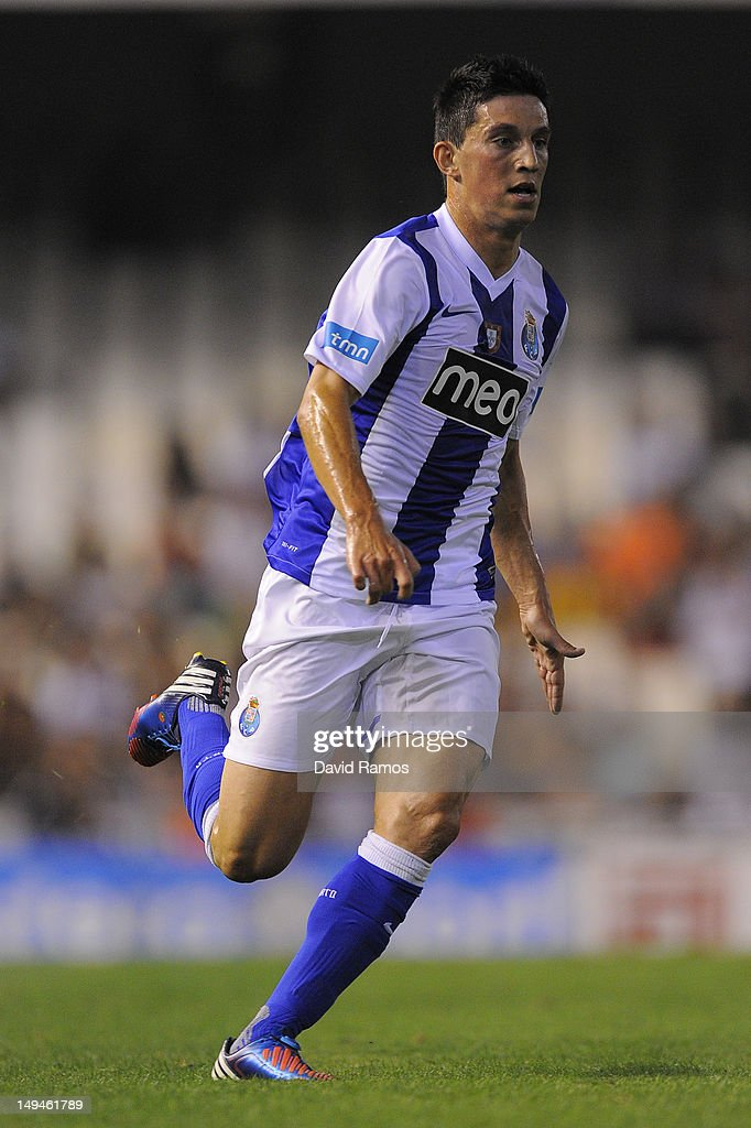 <a gi-track='captionPersonalityLinkClicked' href=/galleries/search?phrase=Andre+Castro&family=editorial&specificpeople=7124527 ng-click='$event.stopPropagation()'>Andre Castro</a> of Porto CF runs with the ball during a Pre-Season friendly match between Valencia CF and FC Porto at Estadio Mestalla on July 28, 2012 in Valencia, Spain.