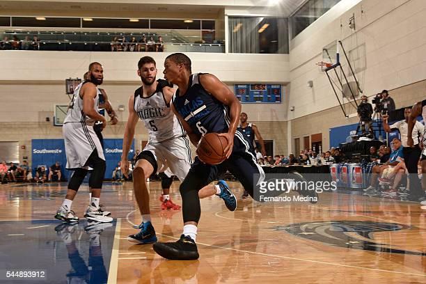 Andre Dawkins of the Dallas Mavericks drives to the basket against Patricio Garino of the Orlando Magic White during the Orlando Summer League on...