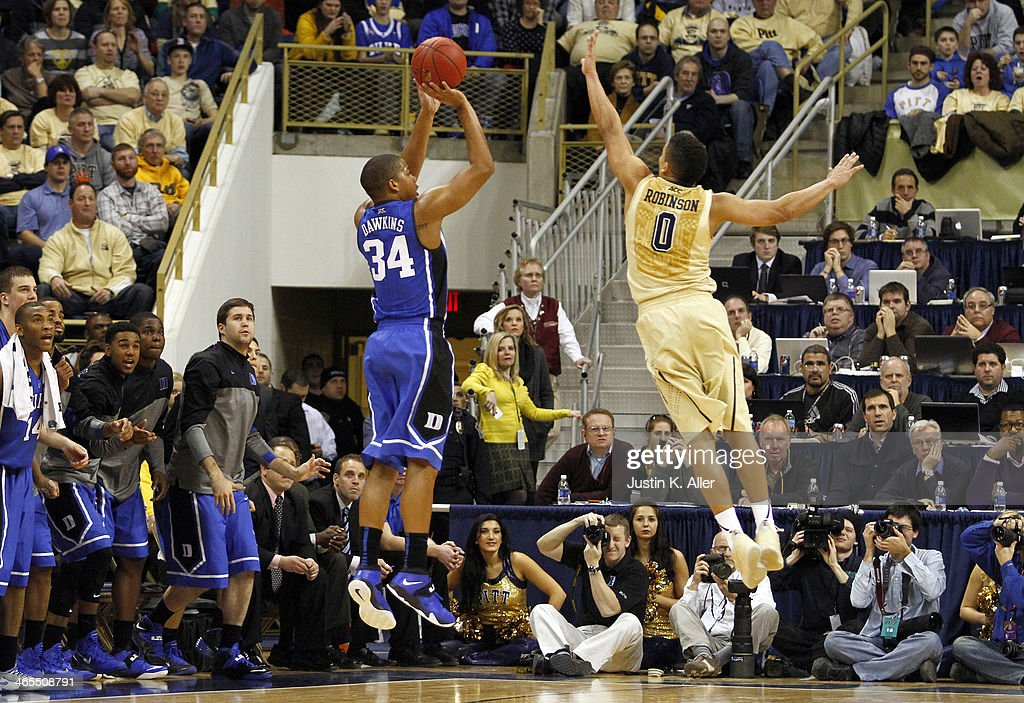 Andre Dawkins #34 of the Duke Blue Devils pulls up for a three-point shot against James Robinson #0 of the Pittsburgh Panthers at Petersen Events Center on January 27, 2014 in Pittsburgh, Pennsylvania.