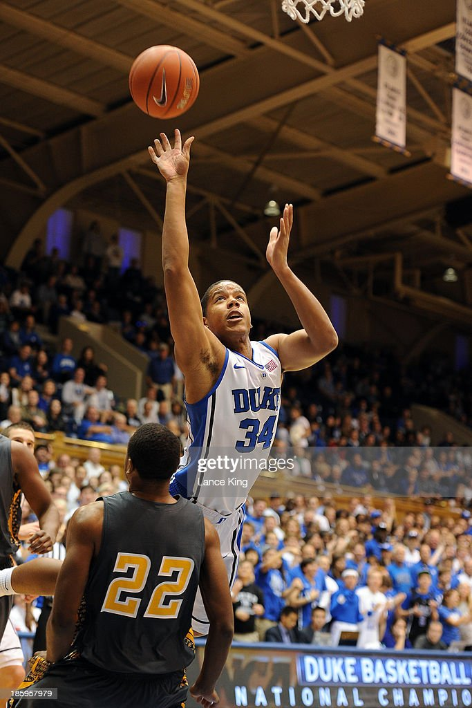 Andre Dawkins #34 of the Duke Blue Devils puts up a shot against Justin Beck #22 of the Bowie State Bulldogs at Cameron Indoor Stadium on October 26, 2013 in Durham, North Carolina. Duke defeated Bowie State 103-67.
