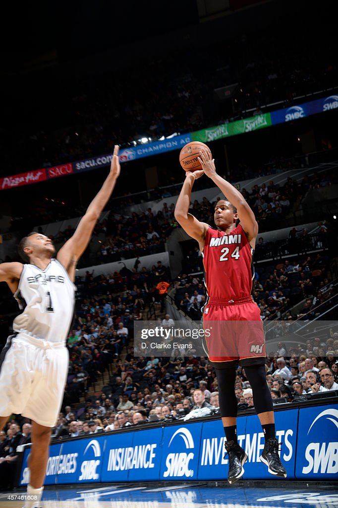 <a gi-track='captionPersonalityLinkClicked' href=/galleries/search?phrase=Andre+Dawkins&family=editorial&specificpeople=6543120 ng-click='$event.stopPropagation()'>Andre Dawkins</a> #24 of the Miami Heat shoots against the San Antonio Spurs at the AT&T Center on October 18, 2014 in San Antonio, Texas.