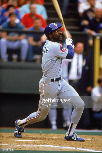 Andre Dawson of the Chicago Cubs makes contact on a pitch during a game circa 198792 against the Cincinnati Reds at Riverfront Stadium in Cincinnati...