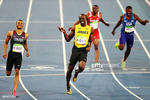 Andre de Grasse of Canada and Usain Bolt of Jamaica react after competing in the Men's 200m Semifinals on Day 12 of the Rio 2016 Olympic Games at the...