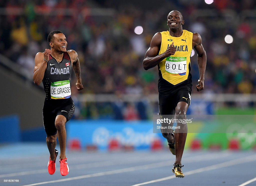 Andre de Grasse of Canada and Usain Bolt of Jamaica react as they compete in the Men's 200m Semifinals on Day 12 of the Rio 2016 Olympic Games at the...