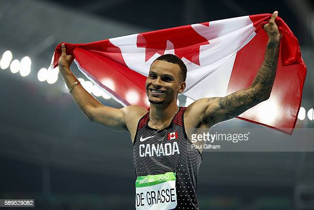 Andre De Grasse of Canada celebrates placing third after the Men's 100 meter final on Day 9 of the Rio 2016 Olympic Games at the Olympic Stadium on...
