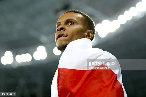 Andre de Grasse of Canada celebrates winning silver in the Men's 200m Final on Day 13 of the Rio 2016 Olympic Games at the Olympic Stadium on August...