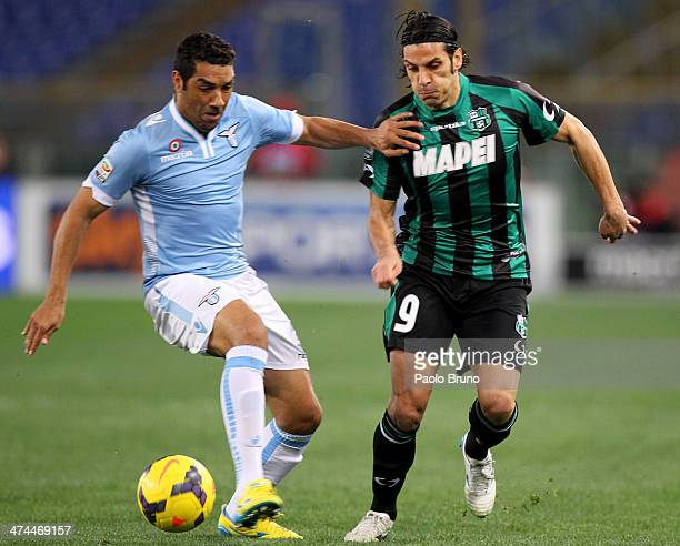 Andre' Dias of SS Lazio competes for the ball with Sergio Floccari of US Sassuolo Calcio during the Serie A match between SS Lazio and US Sassuolo...