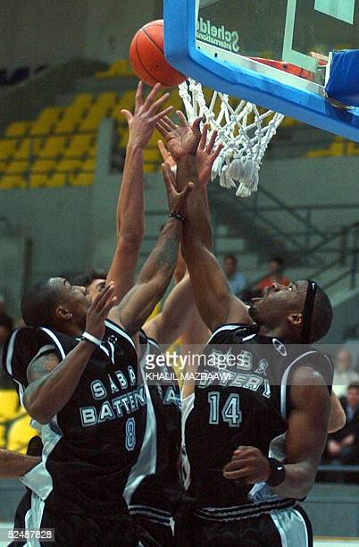 Andre Doran Pitts and Lorenzo Daynard Hall of Iranian Saba Battery club fight for the ball with a player from Syrian AlJeish club during the Eighth...