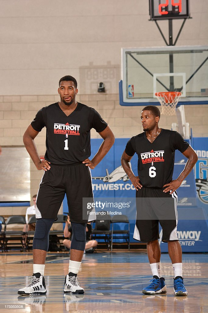 Andre Drummond #1 and Korie Lucious #6 of the Detroit Pistons looks on against the Miami Heat during the 2013 Southwest Airlines Orlando Pro Summer League on July 12, 2013 at Amway Center in Orlando, Florida.