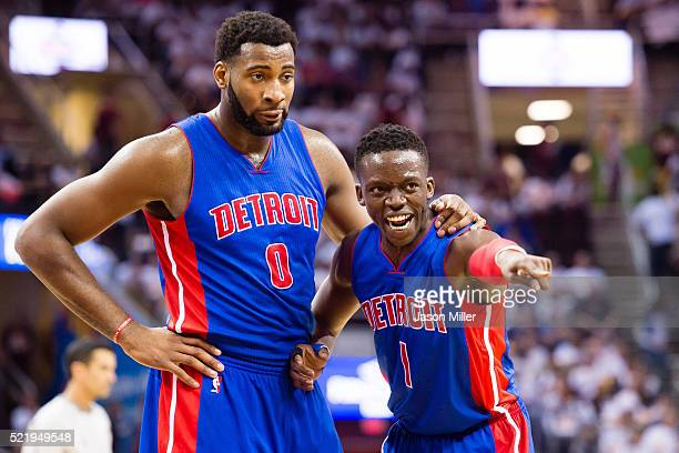 Andre Drummond and Reggie Jackson of the Detroit Pistons talk during a time out in the second half of the NBA Eastern Conference Quarterfinals at...