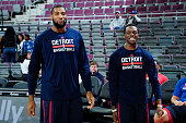 Andre Drummond and Reggie Jackson of the Detroit Pistons warm up before the game against the Washington Wizards on February 22 2015 at Palace of...
