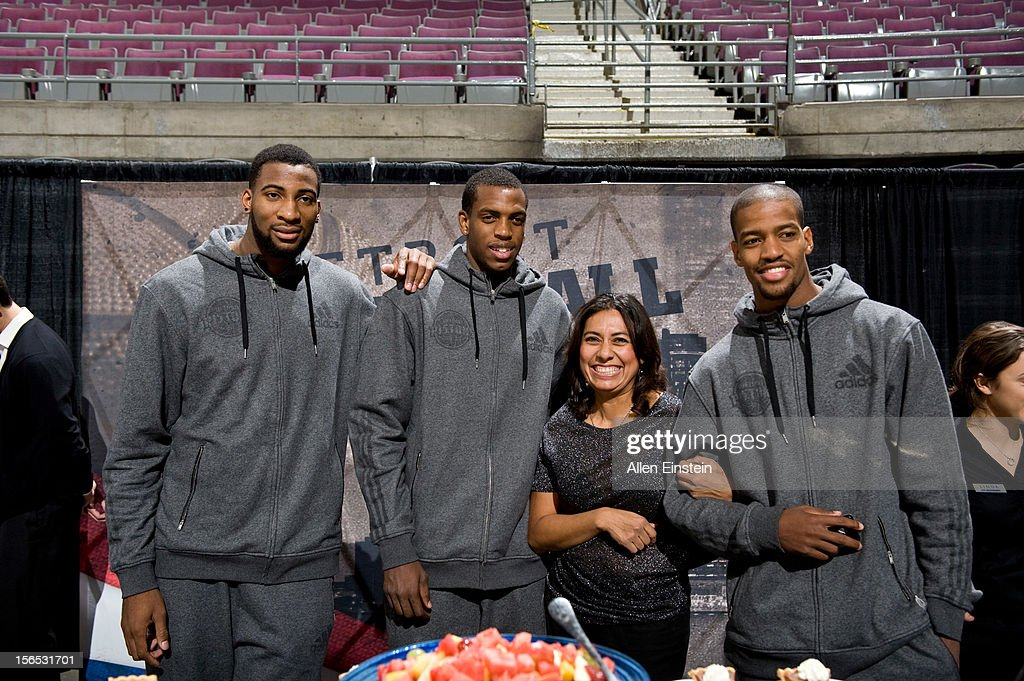 Andre Drummond, Khris Middleton, and Kim English of the Detroit Pistons, pose with a fan during the Detroit Pistons Thanksgiving Feast for 700 deserving metro Detroit guests at the Palace of Auburn Hills on November 15, 2012 in Auburn Hills, Michigan.