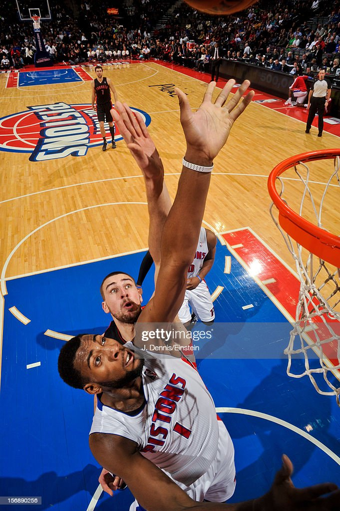 Andre Drummond #1 of the Detroit Pistons and Jonas Valanciunas #17 of the Toronto Raptors try for a rebound on November 23, 2012 at The Palace of Auburn Hills in Auburn Hills, Michigan.