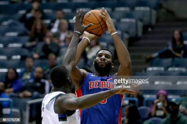 Andre Drummond of the Detroit Pistons attempts a shot over Thon Maker of the Milwaukee Bucks in the third quarter during a preseason game at BMO...