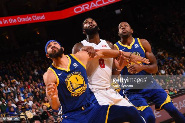 Andre Drummond of the Detroit Pistons battles for position against JaVale McGee and Andre Iguodala of the Golden State Warriors on October 29 2017 at...