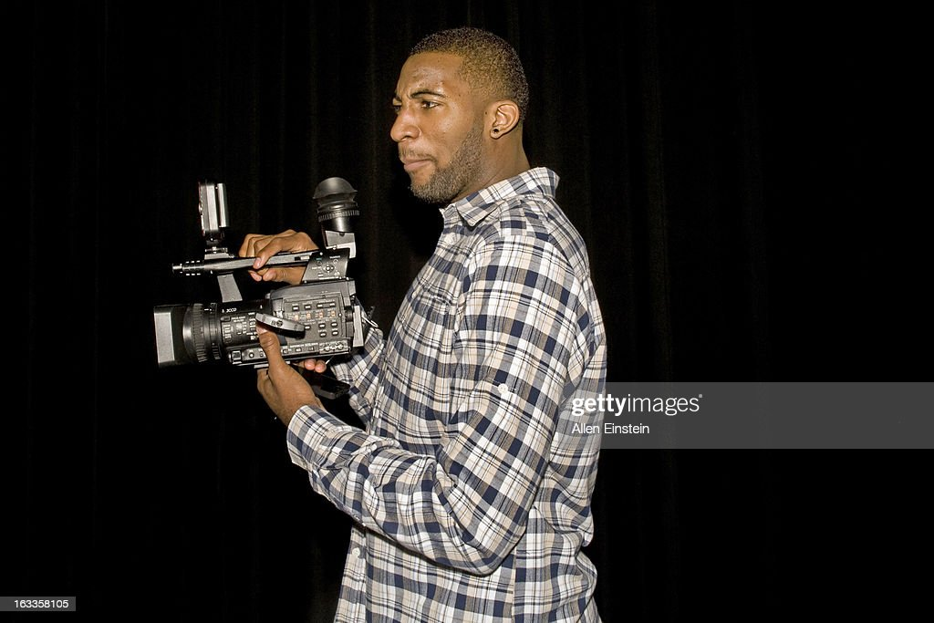 Andre Drummond #1 of the Detroit Pistons, displays his video skills after the Pistons Academy Awards ceremony at Birmingham Groves High School on March 7, 2013 in Birmingham, Michigan.