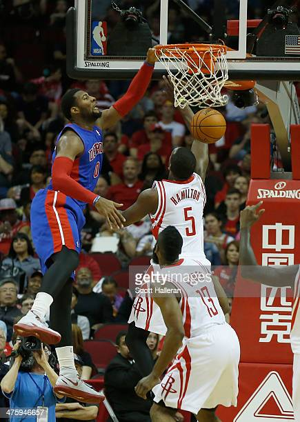 Andre Drummond of the Detroit Pistons dunks over Jordan Hamilton of the Houston Rockets during the game at the Toyota Center on March 1 2014 in...