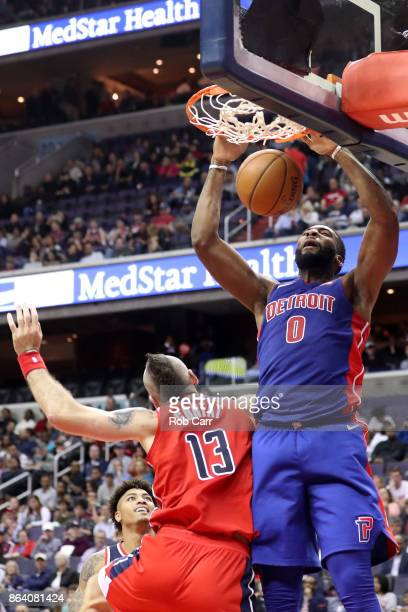 Andre Drummond of the Detroit Pistons dunks over Marcin Gortat of the Washington Wizards in the first half at Capital One Arena on October 20 2017 in...