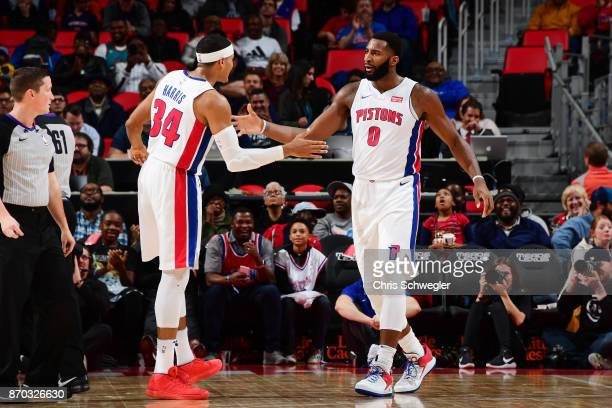 Andre Drummond of the Detroit Pistons gives high five to teammate Tobias Harris of the Detroit Pistons during the game against the Sacramento Kings...
