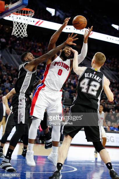 Andre Drummond of the Detroit Pistons grabs a first half rebound between Dewayne Dedmon and Davis Bertans of the San Antonio Spurs at the Palace of...