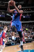 Andre Drummond of the Detroit Pistons grabs a rebound against the Dallas Mavericks on January 7 2015 at the American Airlines Center in Dallas Texas...