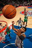 Andre Drummond of the Detroit Pistons grabs the rebound against Boston Celtics on December 16 2015 at The Palace of Auburn Hills in Auburn Hills...