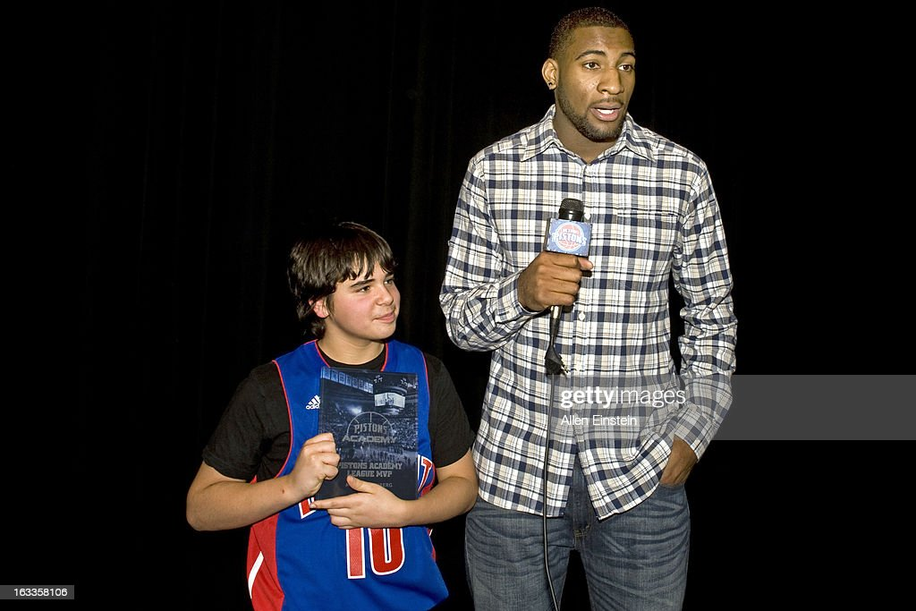 Andre Drummond #1 of the Detroit Pistons interviews the league M.V.P. after the Pistons Academy Awards ceremony at Birmingham Groves High School on March 7, 2013 in Birmingham, Michigan.