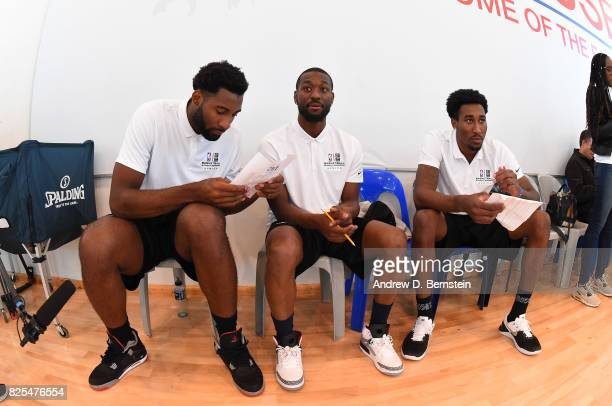 Andre Drummond of the Detroit Pistons Kemba Walker of the Charlotte Hornets and Rondae HollisJefferson evaluates during the Basketball Without...