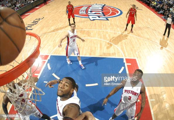 Andre Drummond of the Detroit Pistons looks at the ball to drop through the basket during the game between the Detroit Pistons and the Toronto...
