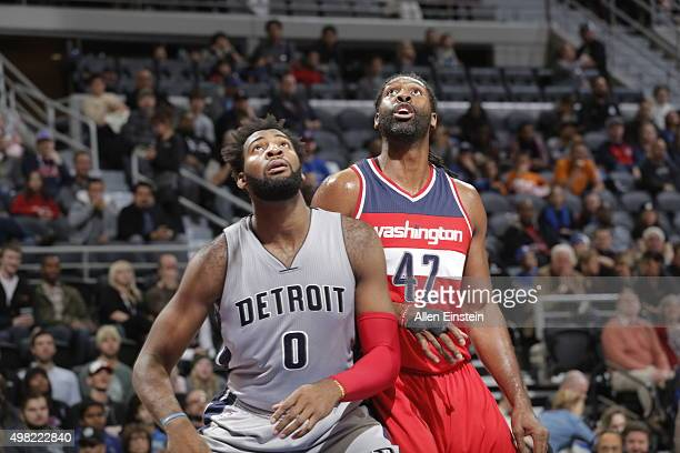 Andre Drummond of the Detroit Pistons looks for the rebound against Nene Hilario of the Washington Wizards during the game on November 21 2015 at The...