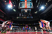 Andre Drummond of the Detroit Pistons prepares to take a free throw against the Atlanta Hawks on December 23 2015 at Philips Arena in Atlanta Georgia...