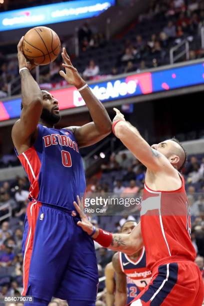 Andre Drummond of the Detroit Pistons puts up a shot against Marcin Gortat of the Washington Wizards in the first half at Capital One Arena on...