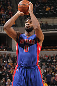 Andre Drummond of the Detroit Pistons shoots a free throw against the Indiana Pacers on January 2 2016 at Bankers Life Fieldhouse in Indianapolis...