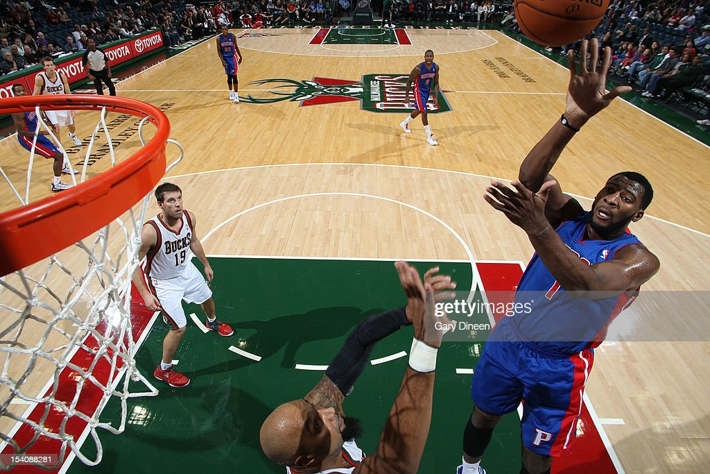 <a gi-track='captionPersonalityLinkClicked' href=/galleries/search?phrase=Andre+Drummond&family=editorial&specificpeople=7122456 ng-click='$event.stopPropagation()'>Andre Drummond</a> #1 of the Detroit Pistons shoots against <a gi-track='captionPersonalityLinkClicked' href=/galleries/search?phrase=Drew+Gooden&family=editorial&specificpeople=201750 ng-click='$event.stopPropagation()'>Drew Gooden</a> #0 of the Milwaukee Bucks during the NBA preseason game on October 13, 2012 at the BMO Harris Bradley Center in Milwaukee, Wisconsin.
