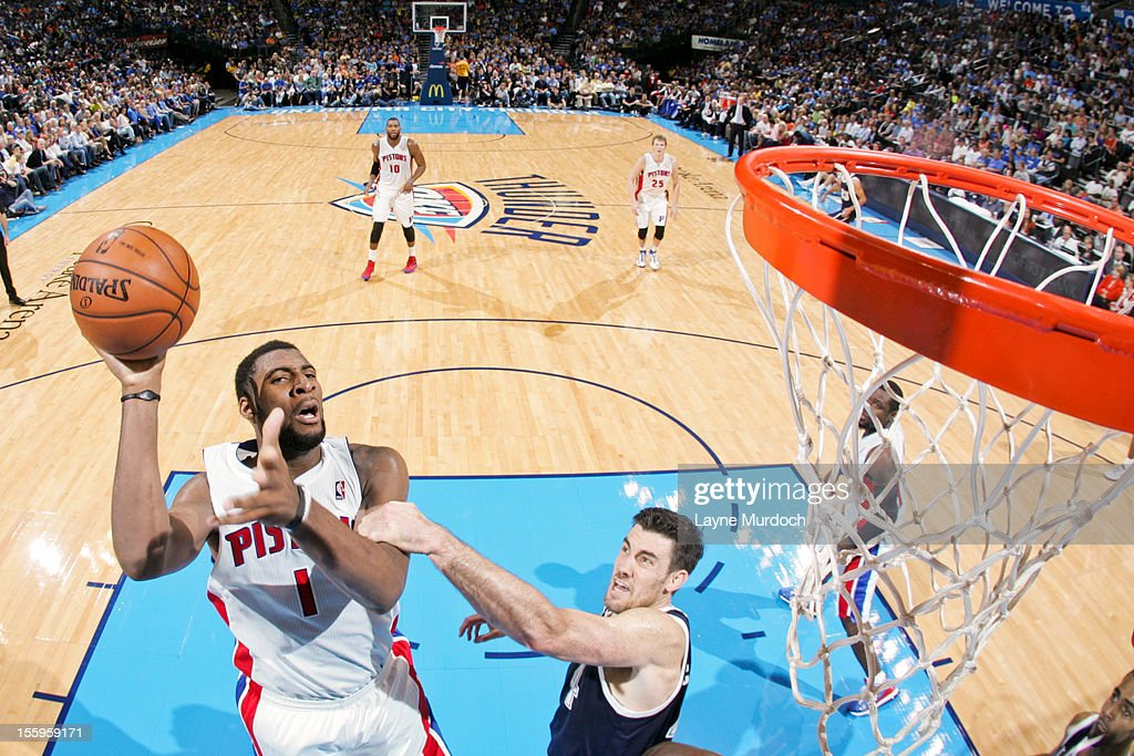 <a gi-track='captionPersonalityLinkClicked' href=/galleries/search?phrase=Andre+Drummond&family=editorial&specificpeople=7122456 ng-click='$event.stopPropagation()'>Andre Drummond</a> #1 of the Detroit Pistons shoots against <a gi-track='captionPersonalityLinkClicked' href=/galleries/search?phrase=Nick+Collison&family=editorial&specificpeople=202843 ng-click='$event.stopPropagation()'>Nick Collison</a> #4 of the Oklahoma City Thunder on November 9, 2012 at the Chesapeake Energy Arena in Oklahoma City, Oklahoma.