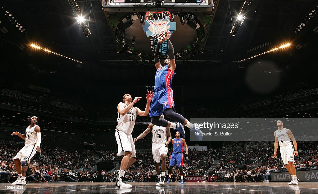 Andre Drummond #1 of the Detroit Pistons shoots past Brook Lopez #11 of the Brooklyn Nets on April 17, 2013 at the Barclays Center in the Brooklyn borough of New York City.