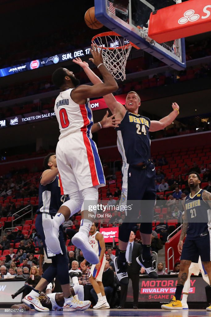 Andre Drummond #0 of the Detroit Pistons shoots the ball against the Denver Nuggets at Little Caesars Arena on December 12, 2017 in Detroit, Michigan.