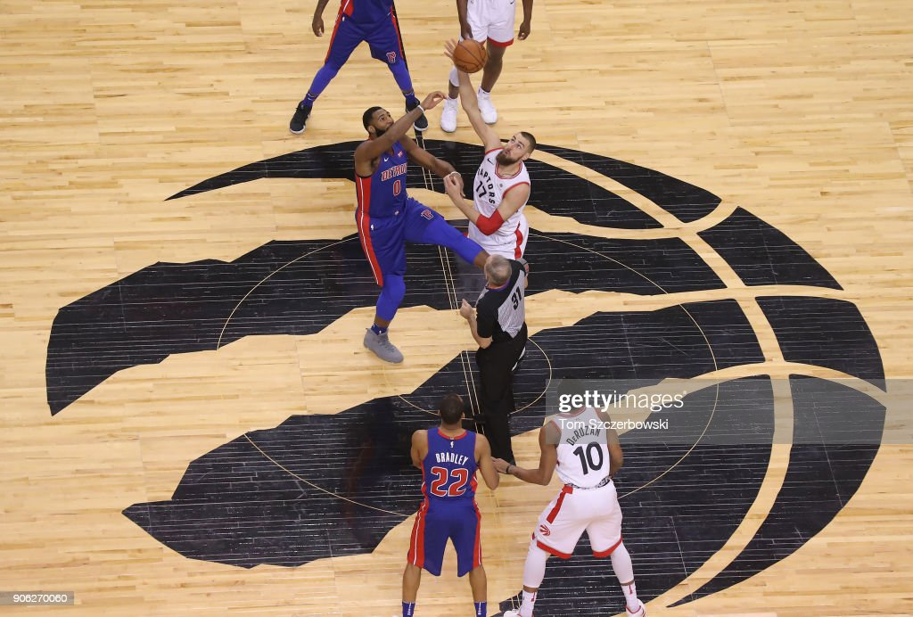 Andre Drummond #0 of the Detroit Pistons tips off against Jonas Valanciunas #17 of the Toronto Raptors at Air Canada Centre on January 17, 2018 in Toronto, Canada.