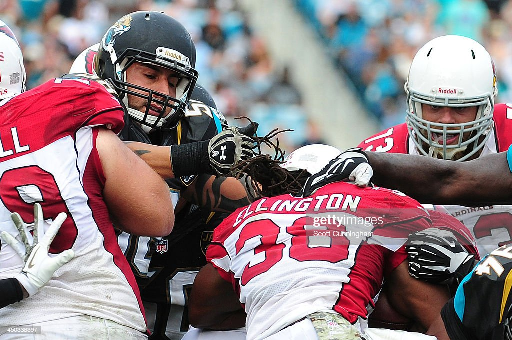 Andre Ellington #38 of the Arizona Cardinals has his hair pulled as he is tackled by Jason Babin #58 of the Jacksonville Jaguars at EverBank Field on November 17, 2013 in Jacksonville, Florida.