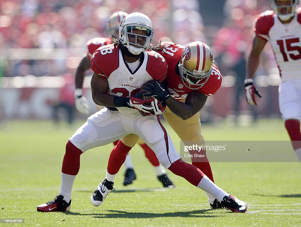 <a gi-track='captionPersonalityLinkClicked' href=/galleries/search?phrase=Andre+Ellington&family=editorial&specificpeople=5519153 ng-click='$event.stopPropagation()'>Andre Ellington</a> #38 of the Arizona Cardinals is hit by <a gi-track='captionPersonalityLinkClicked' href=/galleries/search?phrase=Donte+Whitner&family=editorial&specificpeople=649027 ng-click='$event.stopPropagation()'>Donte Whitner</a> #31 of the San Francisco 49ers at Candlestick Park on October 13, 2013 in San Francisco, California.