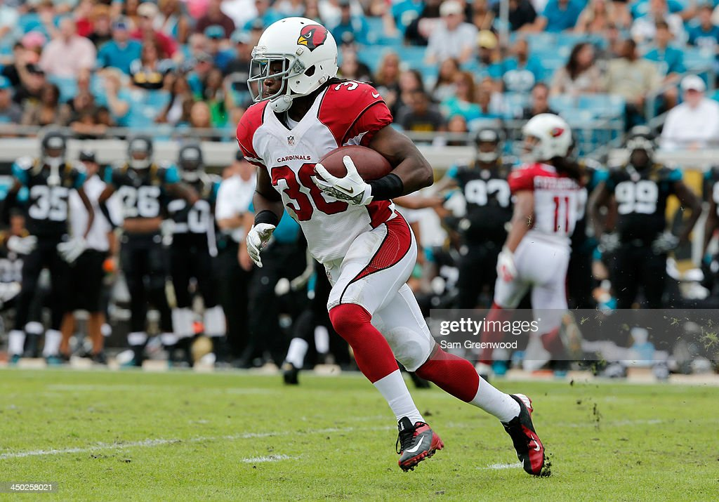 <a gi-track='captionPersonalityLinkClicked' href=/galleries/search?phrase=Andre+Ellington&family=editorial&specificpeople=5519153 ng-click='$event.stopPropagation()'>Andre Ellington</a> #38 of the Arizona Cardinals runs for yardage during the game against the Jacksonville Jaguars at EverBank Field on November 17, 2013 in Jacksonville, Florida.
