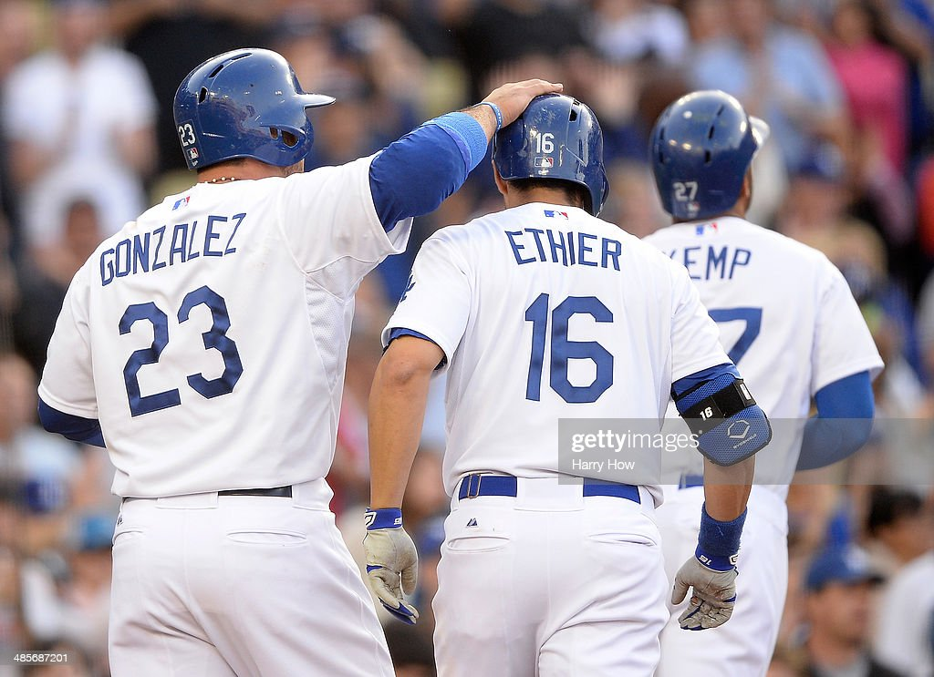 Andre Ethier #16 of the Los Angeles Dodgers celebrates his three run homerun with Adrian Gonzalez #23 and Matt Kemp #27 to trail 4-3 to the Arizona Diamondbacks during the fourth inning at Dodger Stadium on April 19, 2014 in Los Angeles, California.
