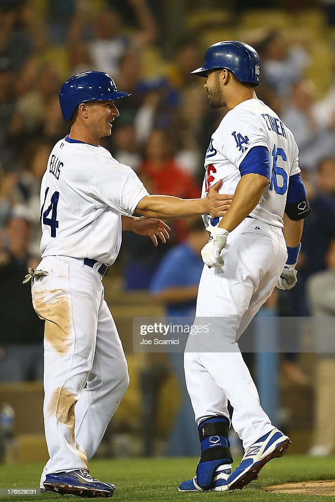 <a gi-track='captionPersonalityLinkClicked' href=/galleries/search?phrase=Andre+Ethier&family=editorial&specificpeople=543213 ng-click='$event.stopPropagation()'>Andre Ethier</a> #16 of the Los Angeles Dodgers celebrates with <a gi-track='captionPersonalityLinkClicked' href=/galleries/search?phrase=Mark+Ellis+-+Baseball+Player&family=editorial&specificpeople=213759 ng-click='$event.stopPropagation()'>Mark Ellis</a> #14 of the Los Angeles Dodgers after hitting a two run home run in the ninth inning to tie up the game against the New York Mets at Dodger Stadium on August 14, 2013 in Los Angeles, California.