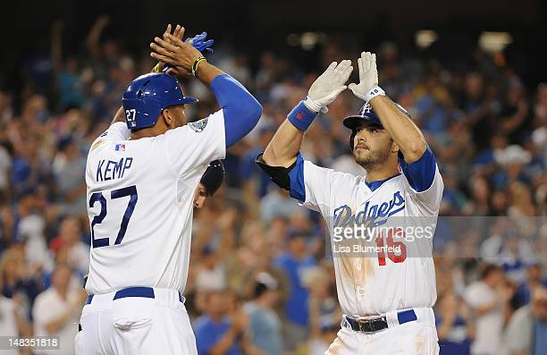 Andre Ethier of the Los Angeles Dodgers celebrates with teammate Matt Kemp after hitting a two run homerun in the sixth inning against the San Diego...