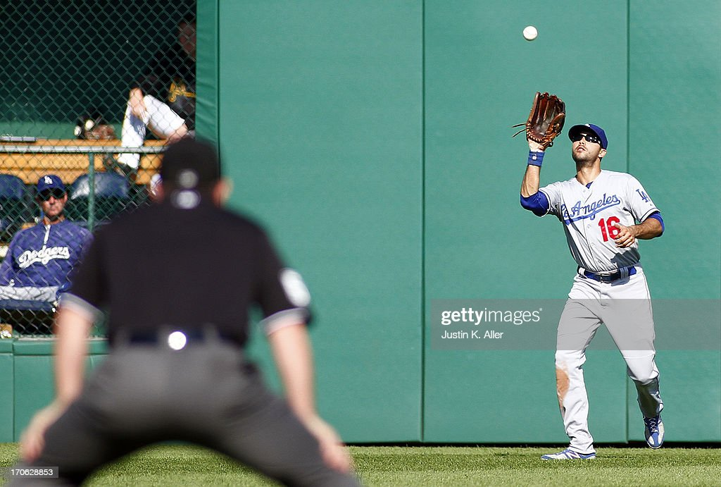 <a gi-track='captionPersonalityLinkClicked' href=/galleries/search?phrase=Andre+Ethier&family=editorial&specificpeople=543213 ng-click='$event.stopPropagation()'>Andre Ethier</a> #16 of the Los Angeles Dodgers fields a fly ball in the fifth inning against the Pittsburgh Pirates during the game on June 15, 2013 at PNC Park in Pittsburgh, Pennsylvania.