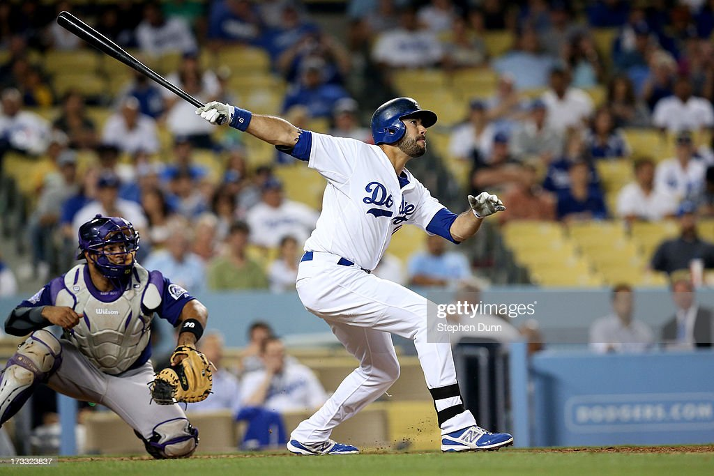 Andre Ethier #16 of the Los Angeles Dodgers hits a sacrifice fly ot make the score 6-0 in the eighth inning against the Colorado Rockies at Dodger Stadium on July 11, 2013 in Los Angeles, California. The Dodgers won 6-1.